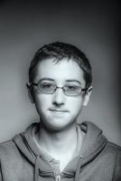 Caucasian teenage boy wearing eyeglasses