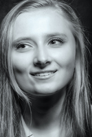 Close up of smiling teenage girl looking away