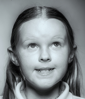 Close up of smiling Caucasian girl looking up