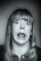 Close up of gasping Caucasian girl with braces