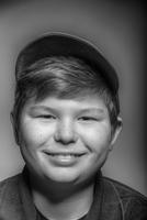 Close up of smiling boy wearing cap