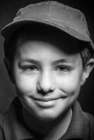 Close up of smiling Caucasian boy wearing cap