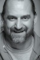 Close up of Caucasian man with beard smiling