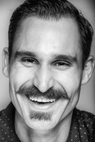 Close up of smiling Caucasian man with mustache
