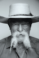 Close up of senior Caucasian man with mustache and straw hat