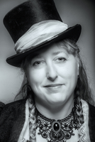 Close up of Caucasian woman wearing top hat