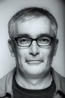 Close up of serious Caucasian man wearing eyeglasses