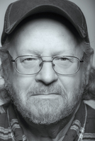 Close up of serious senior Caucasian man with beard and cap