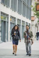 Couple walking on city sidewalk