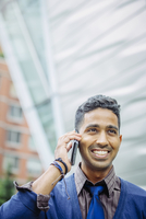 Indian businessman talking on cell phone outdoors