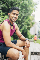 Indian athlete resting in city