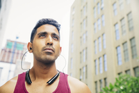 Indian athlete listening to earbuds in city