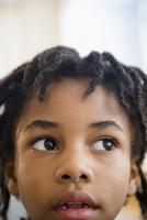 Close up of curious mixed race boy