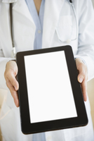 Mixed race doctor showing digital tablet