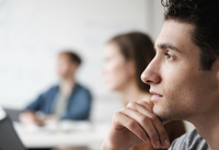 Close up of student listening in college classroom