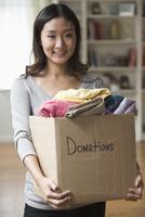 Chinese woman holding donation box