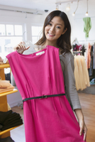 Chinese woman shopping in clothing store