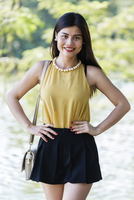 Asian woman standing in park