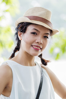 Smiling woman wearing hat in park