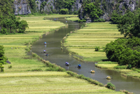 Aerial view of boats floating on Ngo Dong River, Ninh Binh, Ninh Binh, Vietnam