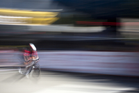 Blurred view of cyclist competing in race