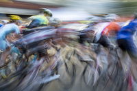 Blurred view of cyclists competing in race