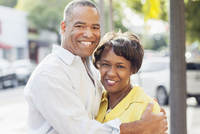 African American couple hugging in city