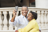 African American couple taking selfie outdoors