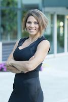 Caucasian businesswoman smiling in city