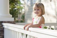 Caucasian girl standing on patio