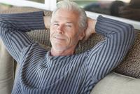 Caucasian man relaxing on sofa