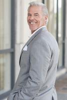Caucasian businessman smiling in city