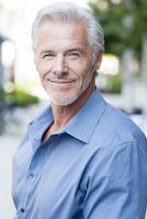 Caucasian businessman smiling outdoors