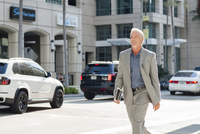 Caucasian businessman walking in city