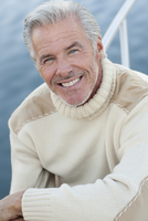 Close up of smiling Caucasian man on boat deck