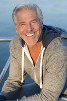 Caucasian man smiling on boat deck