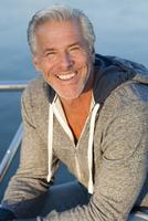 Caucasian man smiling on boat deck