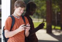 Caucasian teenage boy using cell phone