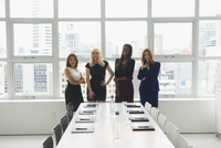 Businesswomen smiling in conference room