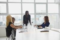 Businesswomen talking in office meeting