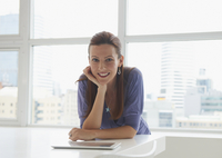 Caucasian businesswoman sitting at conference table in office