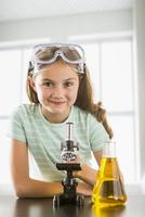 Caucasian girl doing science experiment