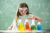 Caucasian girl doing science experiment in classroom