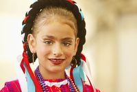 Mixed race girl wearing traditional makeup and dress