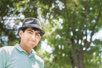 Hispanic teenage boy smiling outdoors