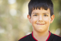 Close up of smiling Hispanic boy