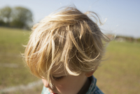 Close up of Caucasian boy in park
