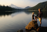 Caucasian father and son standing by Lost Lake, Hood River, Oregon, United States