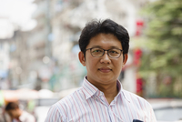 Asian businessman standing in city