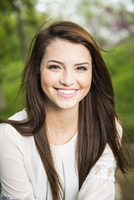Caucasian teenage girl smiling outdoors